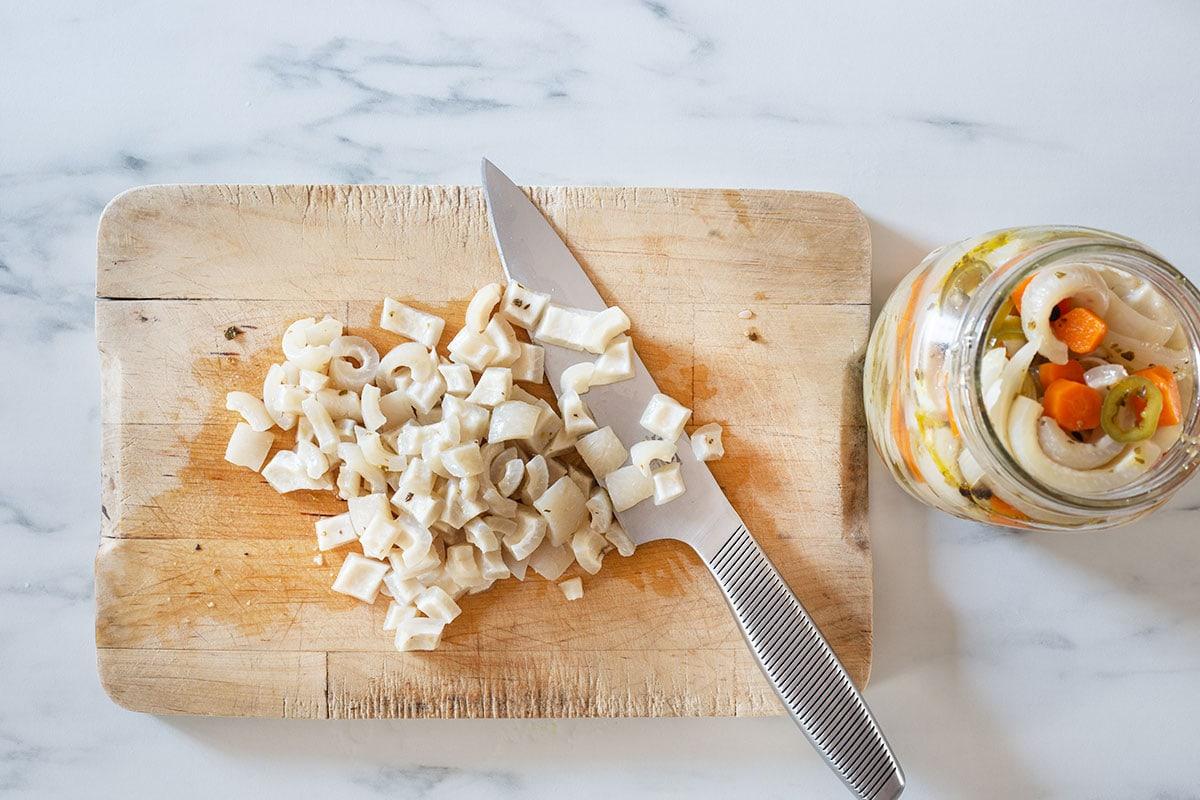 Diced cueritos on a cutting board.