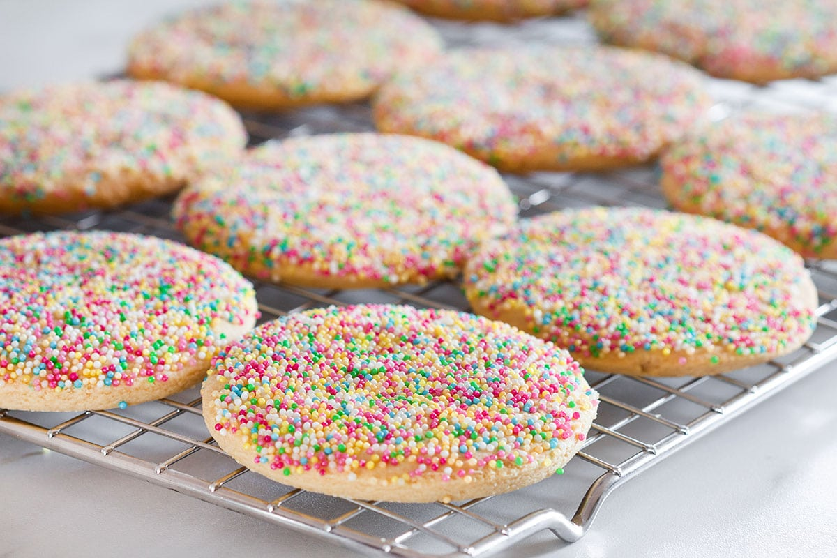 Baked Mexican sprinkle cookies on a cooling rack.