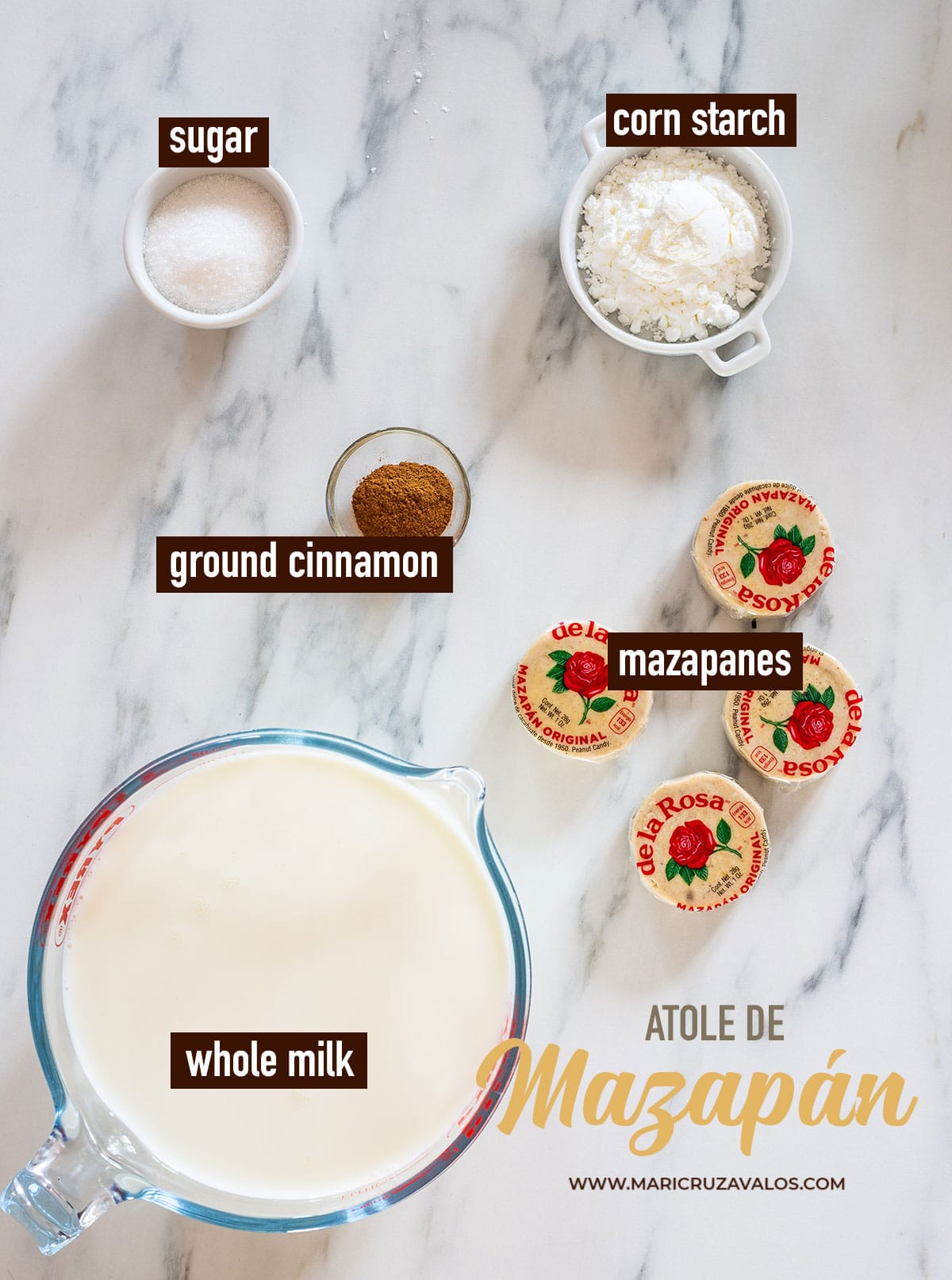 Ingredients for atole de mazapán labeled and displayed on a marble surface.