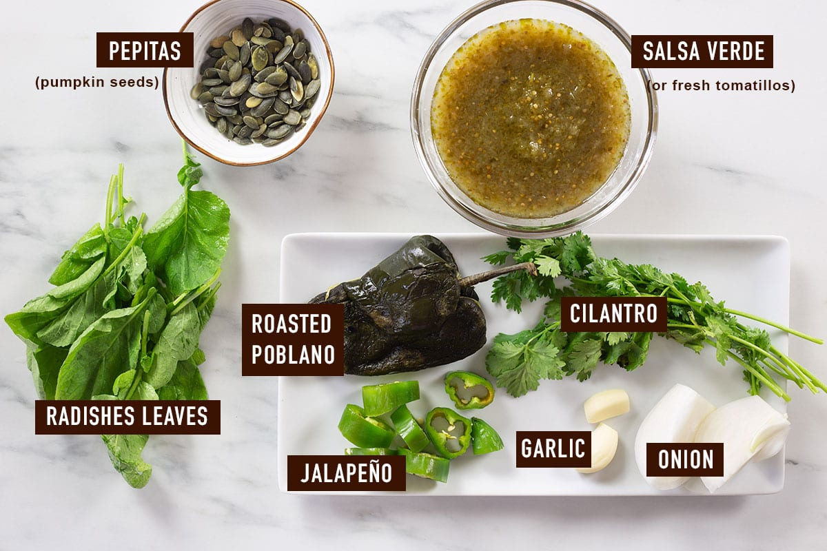 Ingredients for salsa verde labeled on a marble surface.