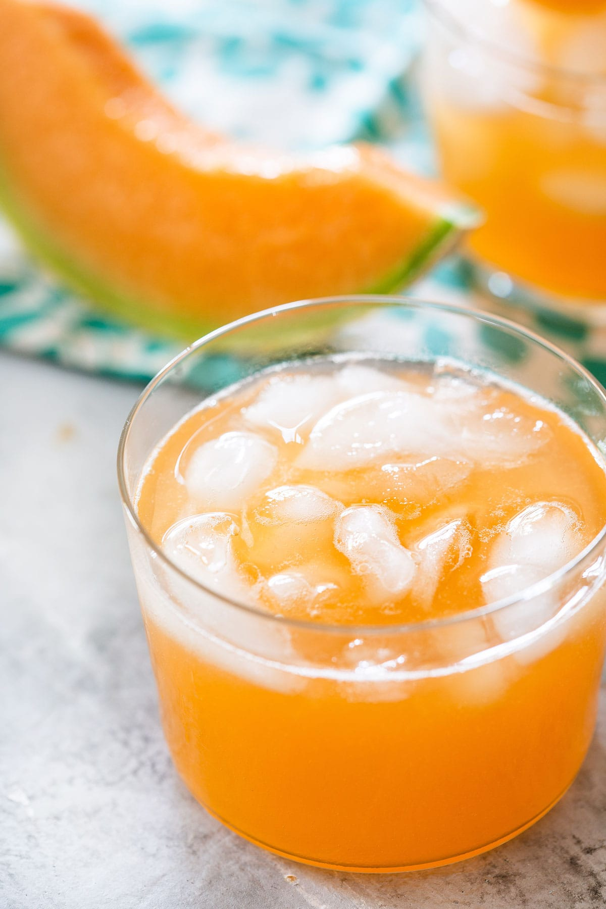 Agua de melon served in a glass with ice.