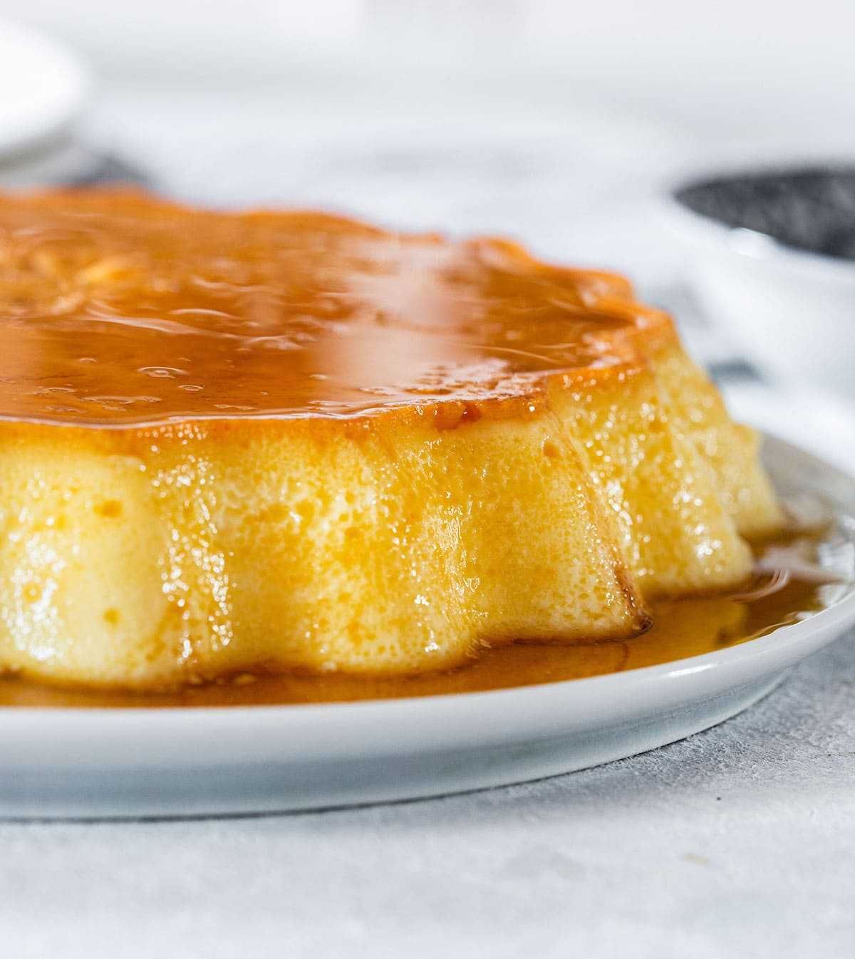 Mexican flan on a serving plate.