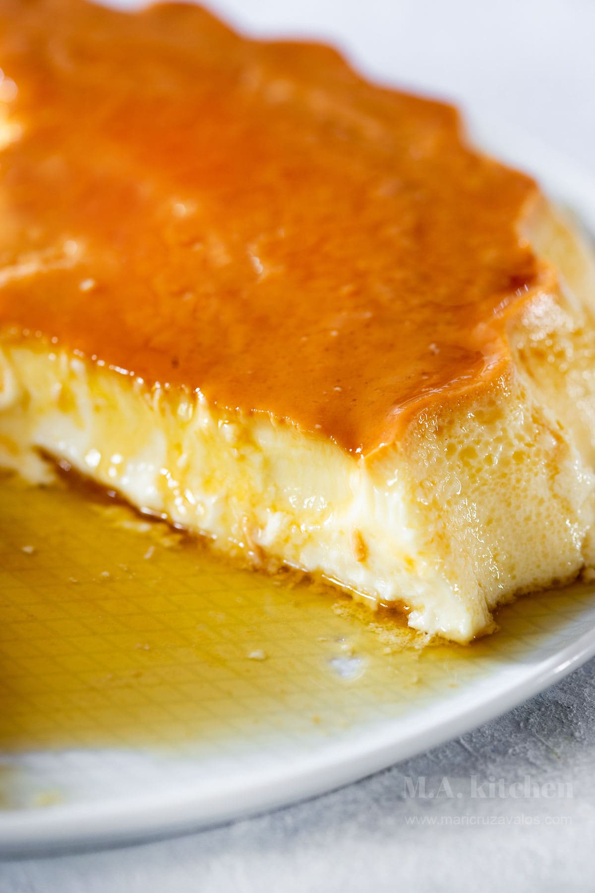 Mexican flan sliced on a serving plate.