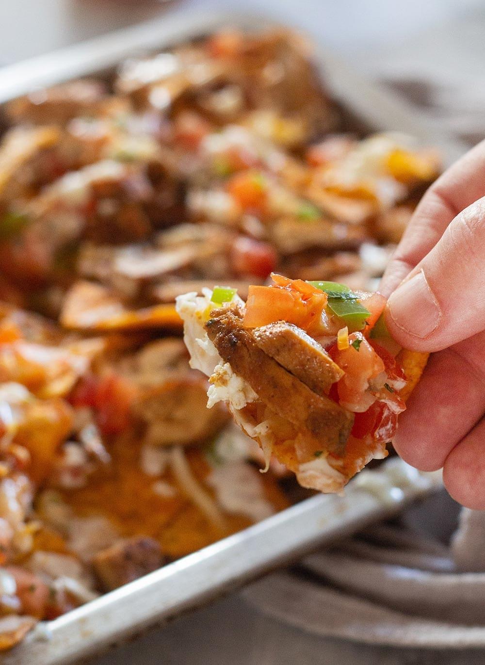 A bite of doritos nachos.