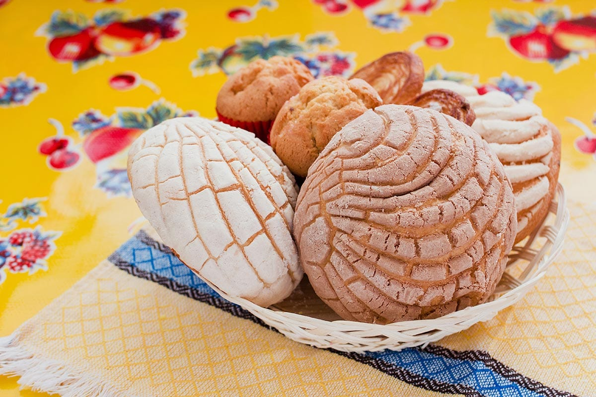 Conchas bread placed on a basket.
