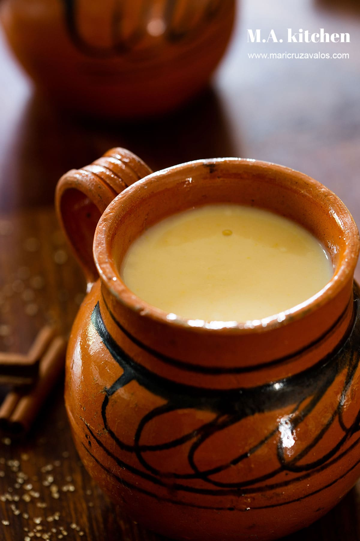 Corn atole in a clay cup.