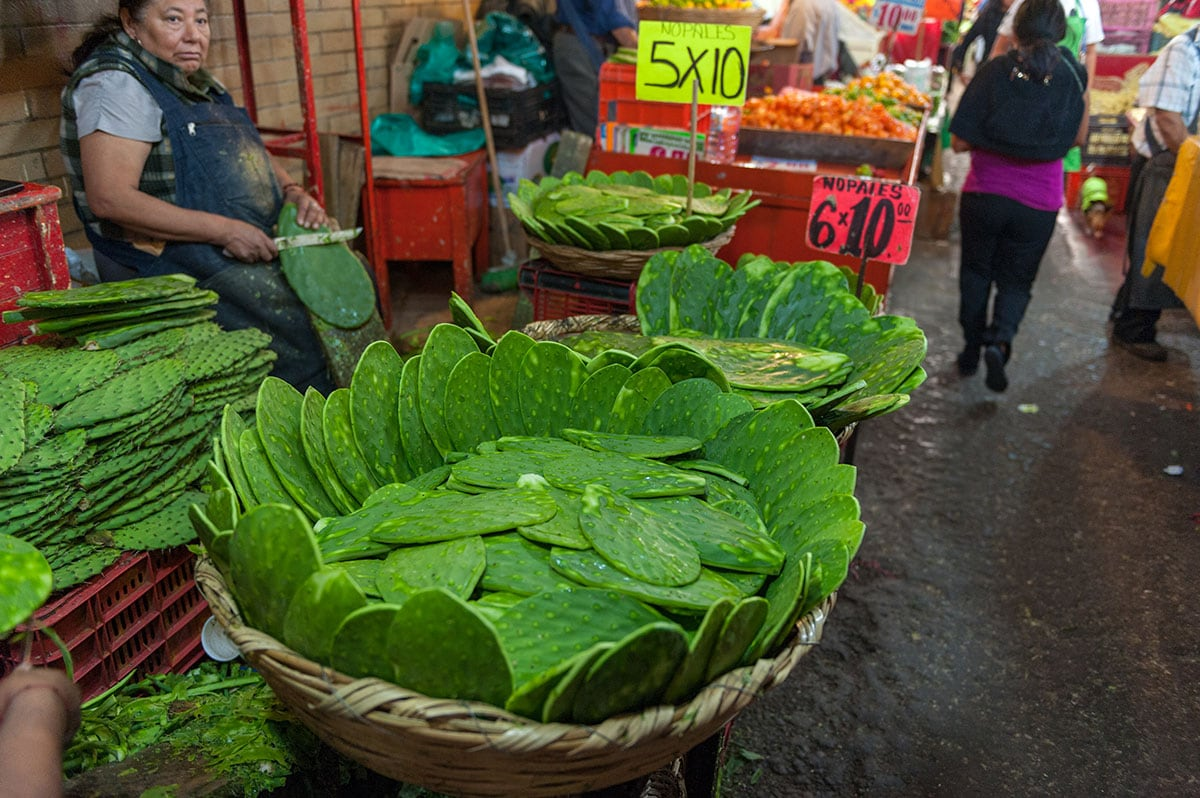 Nopales already cleaned in baskets in a Mexican local market.