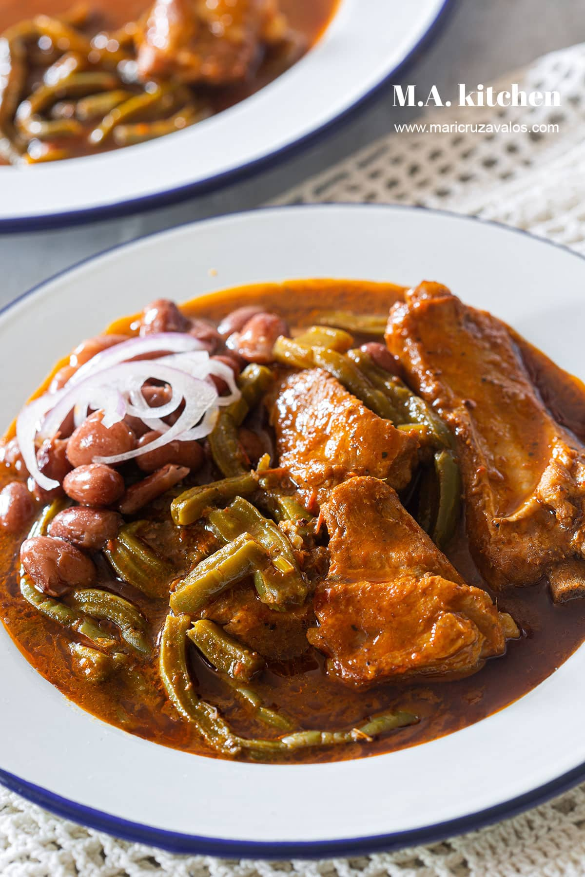 Nopales recipe with pork ribs braised in a chili sauce.