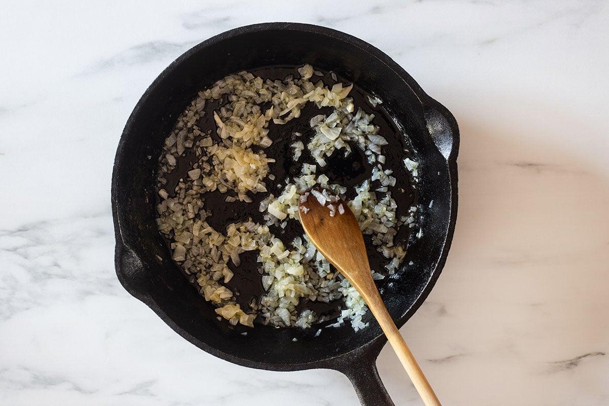 Sautéed onions in a skillet.