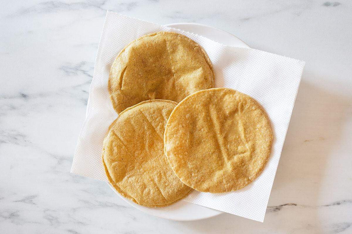 Slightly fried tortillas in a plate.