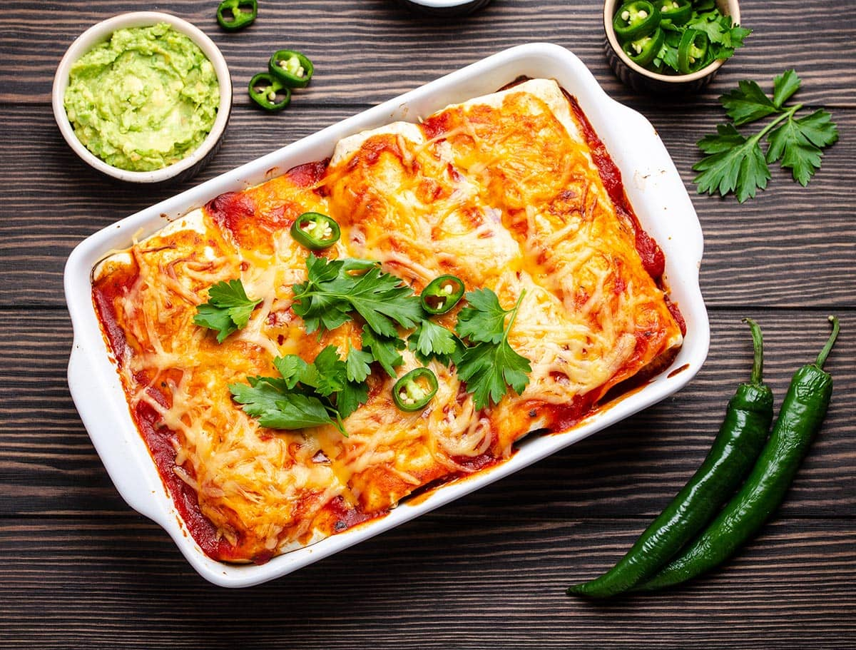 Tex-Mex enchiladas in a baking dish.