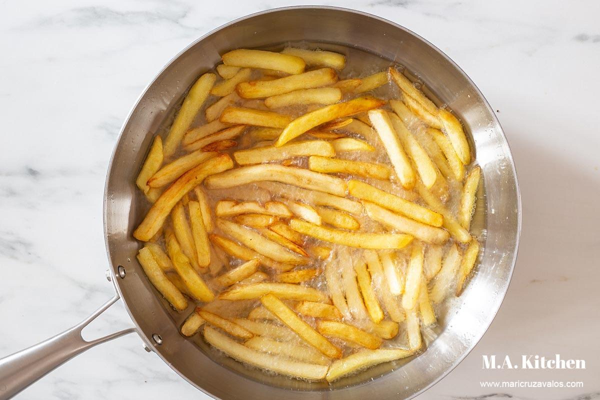 Frying potatoes in a pan.