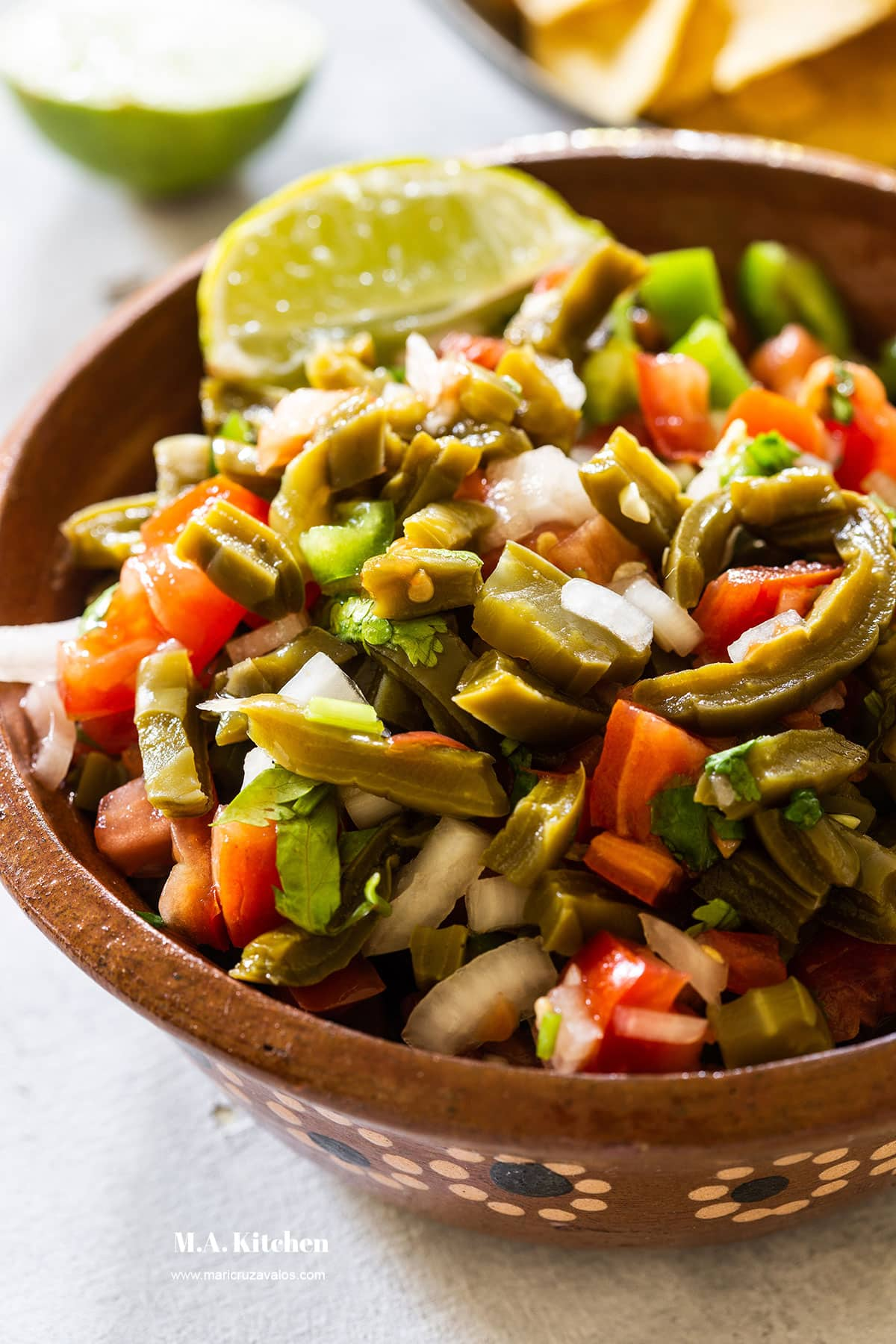Nopales salad served in a clay Mexican bowl.